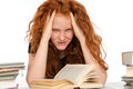 Difficult studies red haired girl has Royalty Free Stock Images