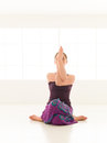 Difficult yoga pose advanced sitting posture by young female indor Stock Image