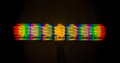 Diffraction of light from the energy saving lamps obtained by the grating a warm fluorescent lamp received via color temperature k Stock Image