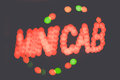 Diffused minicab neon lights of a spelling Royalty Free Stock Photos