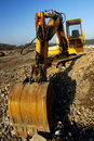 Digger dig out in industrial landscape Royalty Free Stock Photo