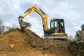 A digger moving soil Royalty Free Stock Photo