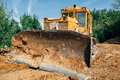 Digger in quarry, heavy duty yellow excavator Royalty Free Stock Photo