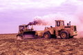 Diggers in the steppe Betpakdala. Royalty Free Stock Photo