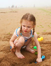 Digging at the Beach Stock Photography
