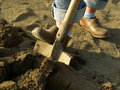 Digging in a garden soil with shovel spring Stock Photo