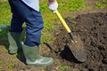 Digging soil image of male farmer in the garden Royalty Free Stock Images