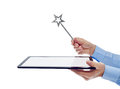 Digital age wizard concept businessman hands with tablet computer and magic wand isolated copyspace Stock Photos