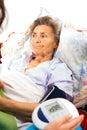Digital blood pressure elderly lady s measured by gauge Stock Images