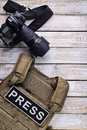 Digital camera and bulletproof vest Royalty Free Stock Photo