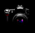 Digital camera isolated on a black background Royalty Free Stock Images