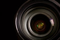 Digital camera lens closeup of over black background Royalty Free Stock Image