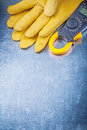 Digital clamp meter safety gloves on metallic background electri Royalty Free Stock Photo