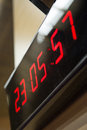 Digital clock on the wall electronic equipment Stock Photos