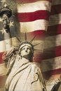Digital composite: Statue of Liberty and American flag is underlaid with the handwriting of the US Constitution