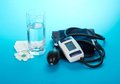 The digital device for measurement of arterial pressure and a tablet on a blue background Royalty Free Stock Photography