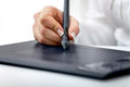 Title: Digital graphics tablet and a hand