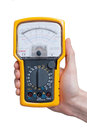 Digital multimeter analog in technicians hand Stock Photos