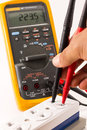 Digital multimeter measuring voltage Royalty Free Stock Photo