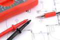 Digital multimeter and pen on plans Royalty Free Stock Photography