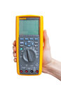 Digital multimeter in technicians hand Royalty Free Stock Image