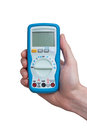 Digital multimeter in technicians hand Stock Image