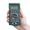 Digital multimeter in technicians hand Royalty Free Stock Photo