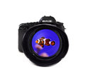 Digital photo camera with clown fish on white background Royalty Free Stock Photos