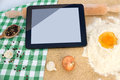 Digital recipe using a tablet at modern kitchen Stock Photo