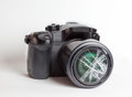 Digital reflex camera with the front lens broken. Royalty Free Stock Photo