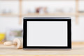 Digital tablet with blank screen and rolling pin closeup of on counter Stock Photos