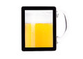 Digital tablet full of of beer isolated Royalty Free Stock Photography