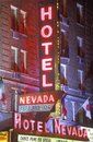 Digitally altered image of a neon sign that reads �Hotel Nevada - Free Parking� Royalty Free Stock Photo