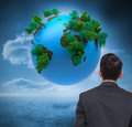 Digitally generated earth floating in air composite image of Royalty Free Stock Photography