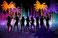 Digitally generated nightlife background with palm trees and people dancing Stock Photo