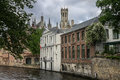 Dijver canal in bruges belgium the with its historical buildings and the belfry or belfort tower Stock Image