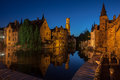 Dijver canal in bruges belgium the with its historical buildings and the belfry or belfort tower reflected on the waters at night Royalty Free Stock Photo
