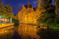 Dijver canal in bruges belgium the with its historical buildings reflected on the waters at night Royalty Free Stock Photography