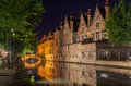Dijver canal in bruges belgium the with its historical buildings reflected on the waters at night Stock Images