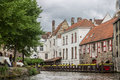 Dijver canal in bruges belgium the with its historical buildings and tourists on a boat Stock Photos