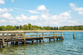 Dilapidated bathing jetty chiemsee for relaxing in light green nature at germany Royalty Free Stock Photos