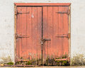 Dilapidated doors on a white building for background Royalty Free Stock Images