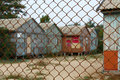 Dilapidated house behind the fence Royalty Free Stock Photo