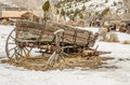 Dilapidated wagon on a winter day in a montana ghost town Stock Photos