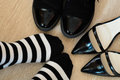 Dilemma concept where the black and white striped socks wearer stand between the with elegant black leather shoes and an elegant Royalty Free Stock Photography