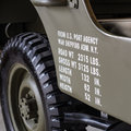 Dimensions and weights printed on the side of a military off roa Royalty Free Stock Photo