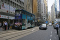 Ding ding tram travelling the streets of central hong kong china april Royalty Free Stock Image