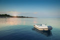 Dinghy on sunset a small in the water frontlight picture Royalty Free Stock Images