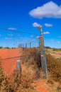 Dingo fence part of the longest in the world at cameron corner in outback australia Stock Photo