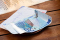 Dining check and euro banknotes with on wooden table Stock Photography
